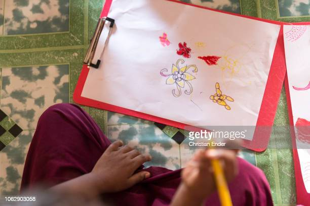 Kutupalong Ukhiya near Cox´s Bazar Bangladesh October 15 2018 Rohingya children draw pictures in a project for education financed by NGOs Refugee...