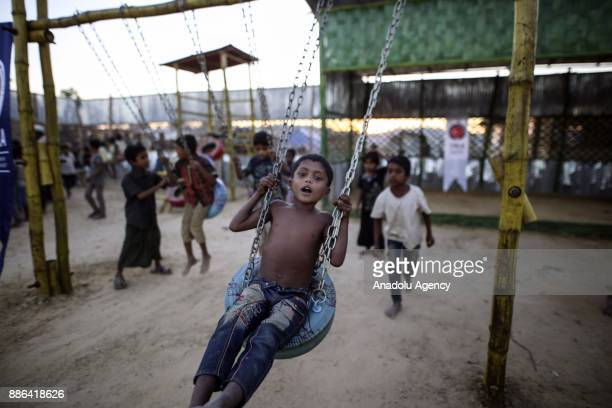 Rohingya children fled from oppression within ongoing military operations in Myanmars Rakhine state play at the playground built by Turkish...