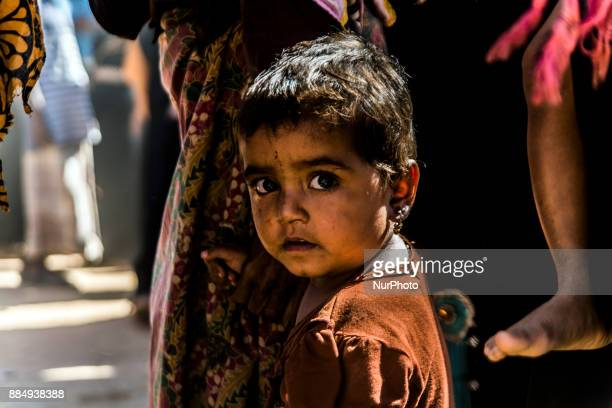 Rohingya children pose for a photo as the Rohingya people live under difficult circumstances at the refugee camp in Coxs Bazar Bangladesh on December...