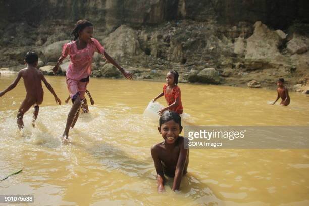 Rohingya children seen playing in muddy rain water More than 600000 Rohingya refugees have fled from Myanmar Rakhine state since August 2017 as most...