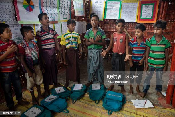 Rohingya children sing We Shall Overcome at a UNICEF learning center August 27 2018 in Balukhali camp Cox's Bazar Bangladesh UN investigators said on...