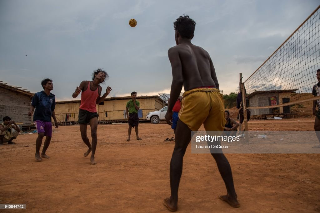 Rohingya construction workers relax at the end of the day by playing chinlone, a traditional Myanmar sport, on April 12, 2018 in Kulim, Malaysia. A group of Rohingya refugees from Myanmar's Rakhine State formed the Rohingya Football Club in Malaysia back in 2015, hoping to give the Rohingya people a voice through sports and raise their international profile amidst the crisis in the region. Rohingya Muslims are reportedly playing in Football Clubs around the world, including Canada, Australia, and Ireland, while the Rohingya F.C. aims to set up a national team which comprises of these players and show that Rakhine Muslims can succeed in the sport. The United Nations estimate that over 62 thousand Rohingya are currently living in Malaysia and most of them are only able to find jobs as a construction worker or laborer with many staying in makeshift homes near construction sites. Malaysia launched its first Rohingya tournament this year with 24 independent football clubs competing across the Muslim country, hoping to gather support from the Malaysian and Turkish governments to help them succeed at an international level. Over 700,000 Muslim Rohingya have crossed the border into Bangladesh since August last year after the Myanmar military launched a brutal crackdown which was described by the United Nations as 'ethnic cleansing' while the two countries continue to negotiate the repatriation of the Rohingya refugees.