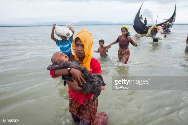 Rohingya ethnic minority people fleeing to a temporary makeshift camp crossing Naf river after crossing over from Myanmar into the Bangladesh side of...