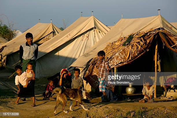 Rohingya families crowd a tented camp November 25 2012 on the outskirts of Sittwe Myanmar An estimated 111000 people were displaced by sectarian...