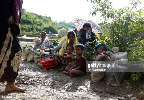 A Rohingya family sit beside a road in Nykkhongchhari Bangladesh on September 2 after fleeing violence in Myanmar Some 400 people most of them...