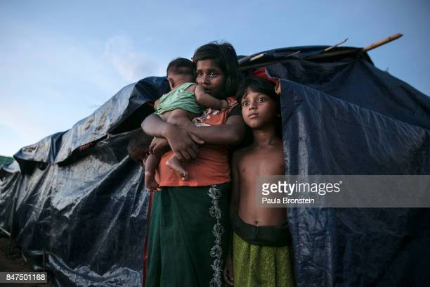Rohingya family stands by their makeshift tent at a new IDP camp on September 15 2017 in Tankhali Bangladesh Nearly 400000 Rohingya refugees have...