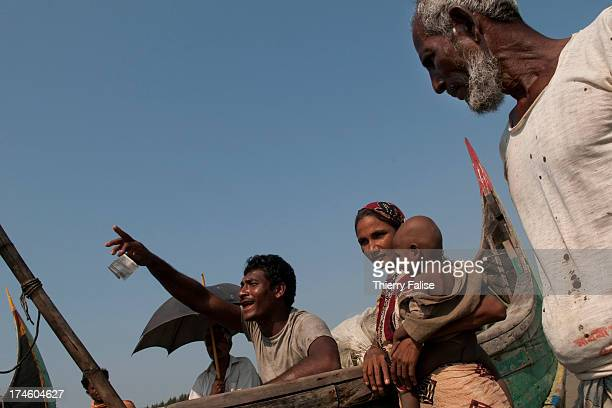 COX'S BAZAR BEACH BANGLADESH Rohingya fishermen return from the sea to meet their family on a Cox's Bazar area beach The Rohingya is a Muslim ethnic...
