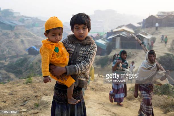 Rohingya girl and her baby brother at Kutupalong refugee camp on February 26, 2018 near Cox's Bazar, Bangladesh. Over 655,000 Rohingya have arrived...