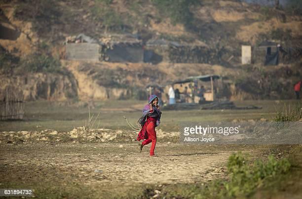 Rohingya girl runs through the Balu Kali refugee camp on January 17 2017 in Cox's Bazar Bangladesh More than 65000 Rohingya Muslims have fled to...