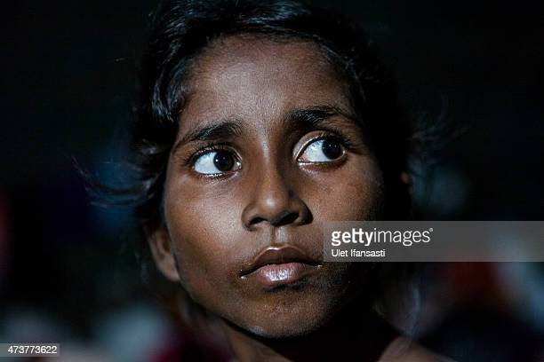 Rohingya girls is seen at a temporary shelter on May 17 2015 in Kuala Langsa Aceh province Indonesia Hundreds of Myanmar's Rohingya refugees arrived...