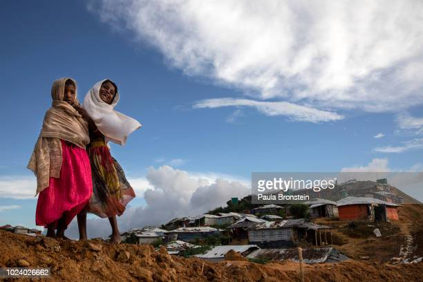 Rohingya girls share a laugh in Kutupalong the largest refugee camp housing the Rohingya on August 26 2018 in Kutupalong Cox's Bazar Bangladesh A...