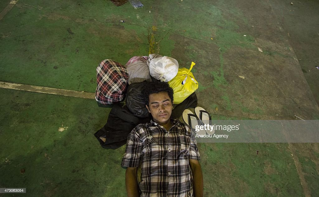 A Rohingya man from Bangladesh and Myanmar takes a rest shelter at Matang Raya village on May 12, 2015 in Northern Aceh, Aceh, Indonesia. 573 Rohingya from Bangladesh and Myanmar were found stranded by Aceh fishermen on North Aceh sea. Rohingya were going to Malaysia with dozens of children and women.