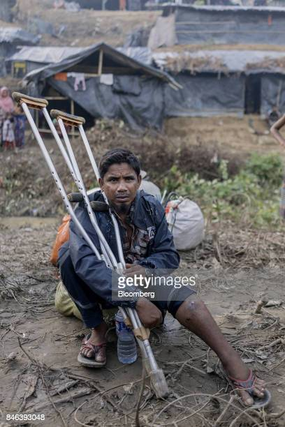 A Rohingya man holds onto a pair of crutches at a newly setup refugee camp at Balukhali in Cox's Bazar Bangladesh on Tuesday Sept 12 2017 Myanmar's...
