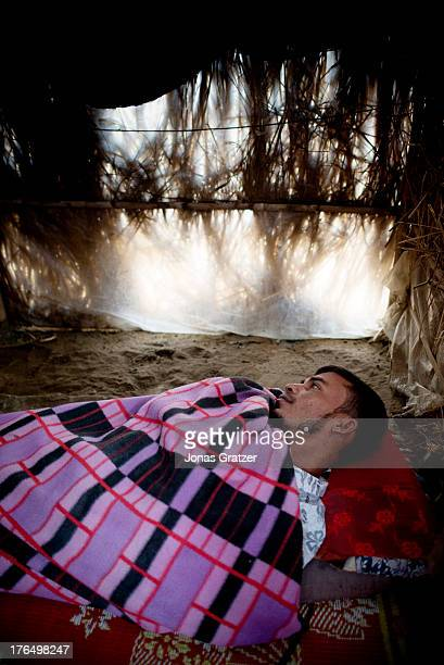 Rohingya man lies on an earthen floor inside his tent whilst suffering from the rapidly spreading dengyfever that has increased after the wet season...