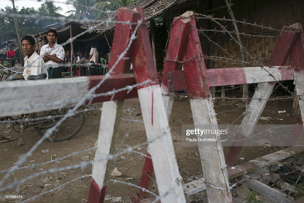 A Rohingya man looks out from a barbed wire fence used as a barrier to restrict travel November 25, 2012 on the outskirts of Sittwe, Myanmar. An estimated 111,000 people were displaced by sectarian violence in June and October, effecting mostly the ethnic Rohingya people, who are now living in crowded IDP camps racially segregated from the Rakhine Buddhists in order to maintain stability. Around 89 lives were lost during a week of violence in October, the worst in decades. As of 2012, 800,000 Rohingya live in Myanmar. According to the UN, they are one of the most persecuted minorities in the world.