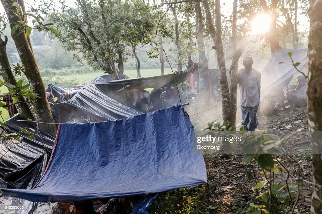 A Rohingya man stands next to makeshift tents at a newly set-up refugee camp at Balukhali in Cox's Bazar, Bangladesh, on Tuesday, Sept. 12, 2017. Myanmar's leaderAung San Suu Kyiis under attack over her response to a fresh round of violence that has seen more than 145,000minorityRohingyaMuslims flee into neighboring Bangladesh since last month. Photographer: Ismail Ferdous/Bloomberg via Getty Images