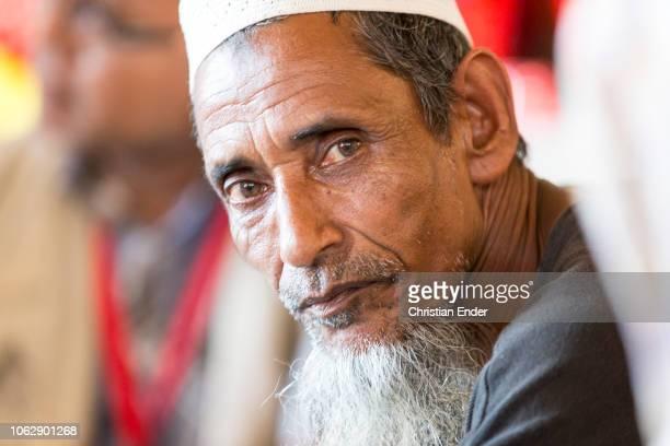 Kutupalong Ukhiya near Cox´s Bazar Bangladesh October 15 2018 A rohingya man wearing a taqiyah sits in a hut Refugee camp of the Rohingyas near Cox's...