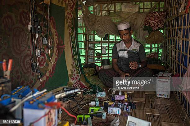 Rohingya man who has invested in solar panels sells electricity to other members of the Dar Paing unregistered internal displacement camp on May 17...