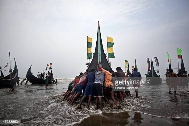 Rohingya men push a fishing boat to sea July 4 2015 in Shamlapur Bangladesh In the past months thousands of Rohingya have landed on the shores of...