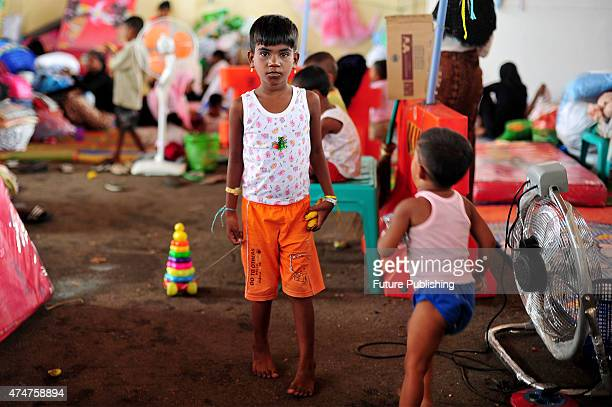 Rohingya migrant girl from Maynmar seen at a temporary shelter in Aceh on May 25 2015 in Kuala Langsa Indonesia Many orphan children are among the...