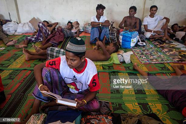 Rohingya migrant reads Koran inside a temporary shelter on May 19 2015 in Kuala Langsa Aceh province Indonesia Hundreds of Myanmar's Rohingya...
