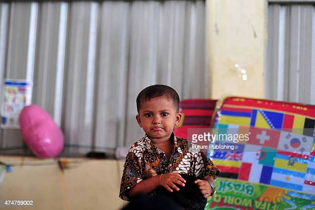 Rohingya migrant Rozuana seen at a temporary shelter in Aceh on May 25 2015 in Kuala Langsa Indonesia Many orphan children are among the refugees and...