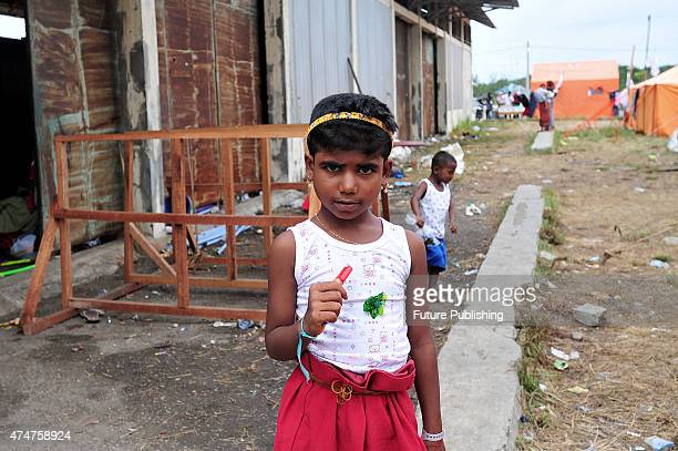Rohingya migrant Zuleha 6 seen playing with other migrant children at a temporary shelter in Aceh on May 25 2015 in Kuala Langsa Indonesia Many...