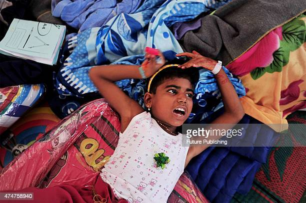 Rohingya migrant Zuleha6 seen at a temporary shelter in Aceh on May 25 2015 in Kuala Langsa Indonesia Many orphan children are among the refugees and...