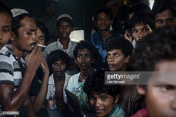 Rohingya migrants are seen on the truck after arriving at the port in Julok village on May 20 2015 in Kuta Binje Aceh Province Indonesia Hundreds of...