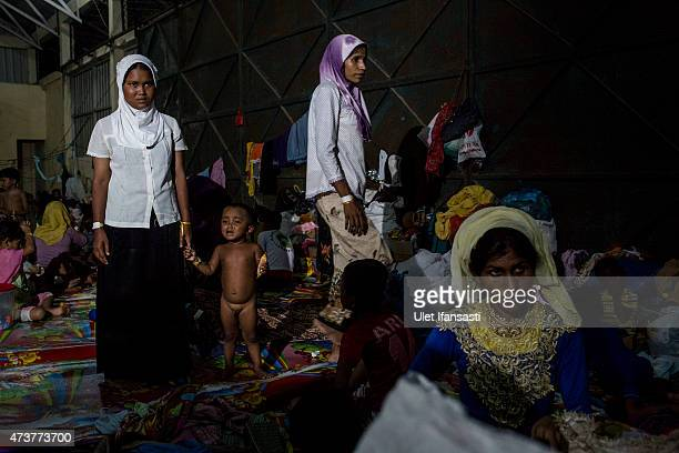 Rohingya migrants are seen rest inside at a temporary shelter on May 17 2015 in Kuala Langsa Aceh province Indonesia Hundreds of Myanmar's Rohingya...