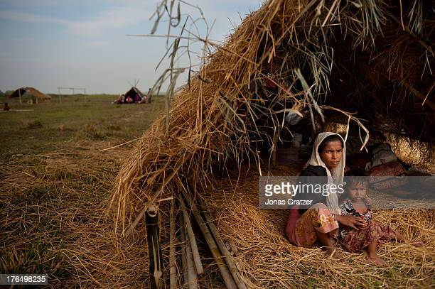 Rohingya mother and son sit in a straw hut located in the IDP refugee camps of Sittwe Sittwe now has over 125000 people who are isolated after...