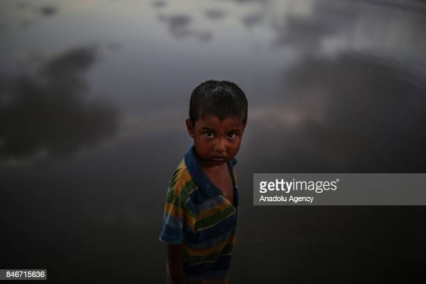 COX'S BAZAR BANGLADESH SEPTEMBER 13 A Rohingya Muslim boy fled from ongoing military operations in Myanmars Rakhine state poses for a photo after...