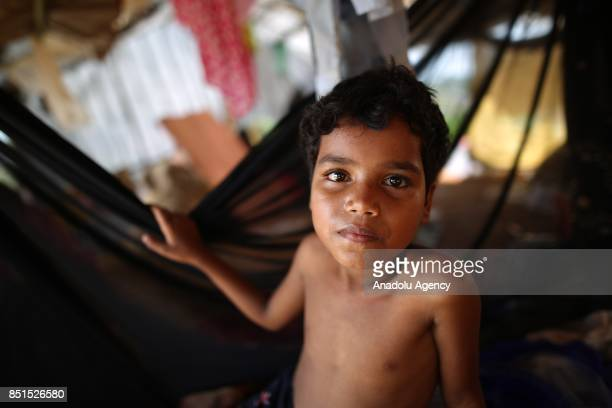 Rohingya Muslim child, fled from ongoing military operations in Myanmars Rakhine state, poses for a photograph in a tent at a makeshift camp in...
