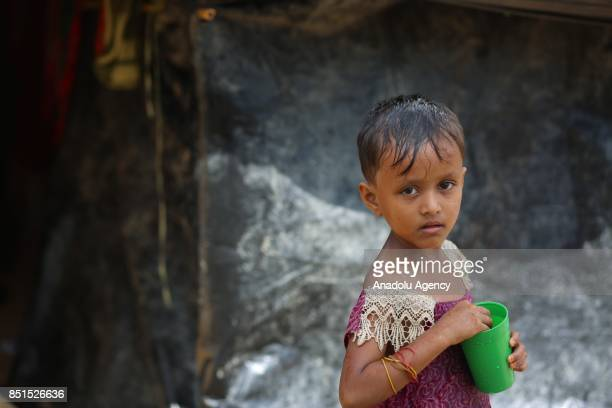 Rohingya Muslim child, fled from ongoing military operations in Myanmars Rakhine state, poses for a photograph near a tent at a makeshift camp in...