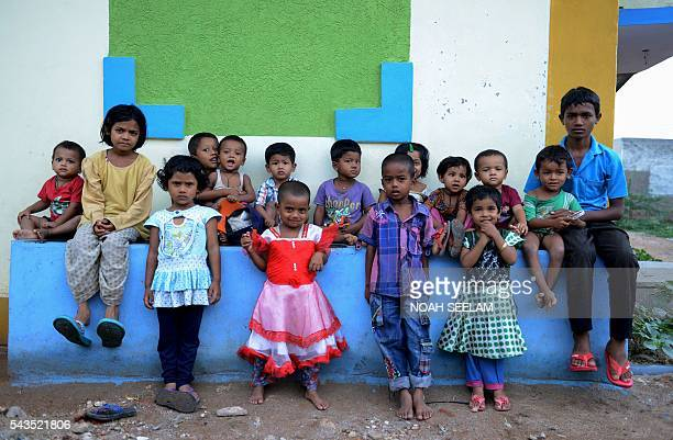 Rohingya Muslim children pose for a photo at a refugee camp in the old city of Hyderabad on June 29 2016 More than 1200 Rohingya Muslims fleeing...