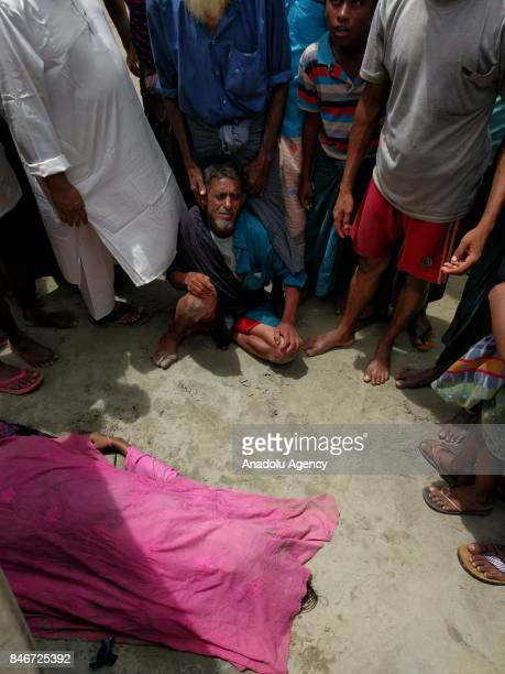 Rohingya Muslim fled from ongoing military operations in Myanmars Rakhine state gestures after their boat sank leaving a child dead and many wounded...