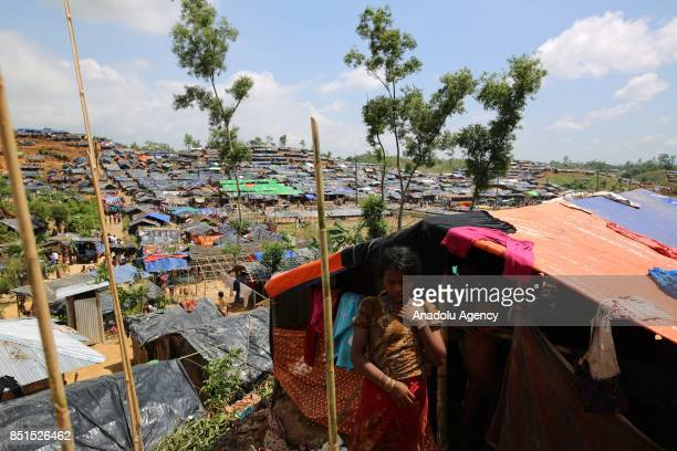 Rohingya Muslim girl, fled from ongoing military operations in Myanmars Rakhine state, poses for a photograph near a tent at a makeshift camp in...