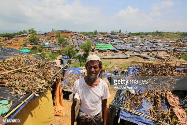 Rohingya Muslim man, fled from ongoing military operations in Myanmars Rakhine state, poses for a photograph near a tent at a makeshift camp in...