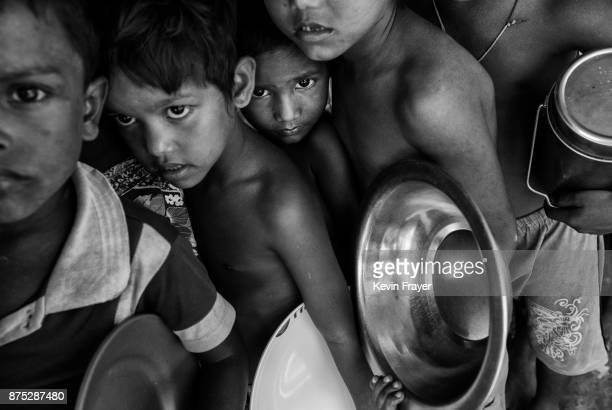 COX'S BAZAR BANGLADESH OCTOBER 26 Rohingya Muslim refugee children crowd as they line up for cooked food at a distribution point of the Turkish aid...
