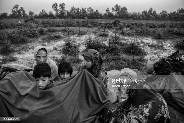 COX'S BAZAR BANGLADESH NOVEMBER 02 A Rohingya Muslim refugee family keeps warm under a blanket after crossing the border from Myanmar into Bangladesh...