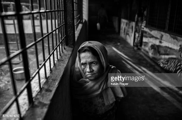 COX'S BAZAR BANGLADESH OCTOBER 24 Rohingya Muslim refugee Gulrukh Khatin stands inside a local school being used as a temporary shelter for new...