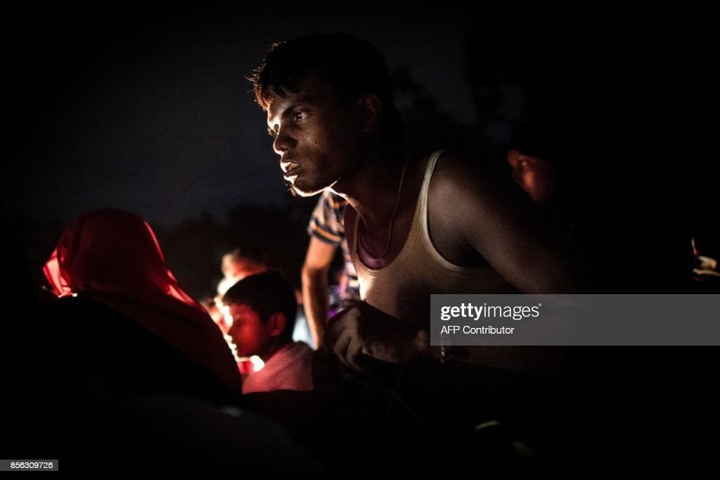 A Rohingya Muslim refugee man waits in a truck to reach a refugee camp after they cross the border from Myanmar, in Teknaf on October 1, 2017. Bangladesh is to move to a camp at least 15,000 Rohingya refugees who have settled in a restive hill district near the border with Myanmar, a local official said Sunday. Most of the estimated half a million Rohingya who have arrived in southeastern Bangladesh over the last five weeks after fleeing violence in Myanmar are crammed into the camps that have sprung up on government land. /
