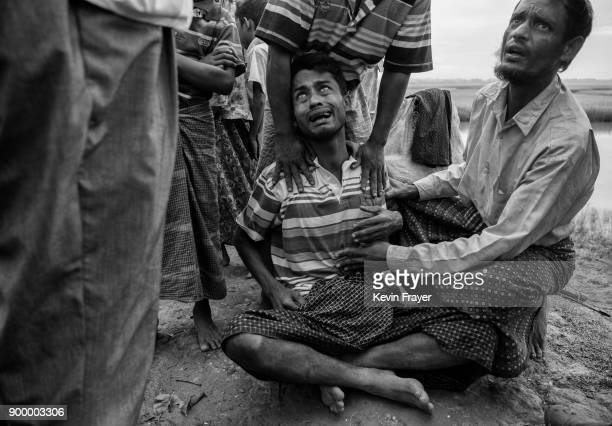 COX'S BAZAR BANGLADESH NOVEMBER 02 A Rohingya Muslim refugee who had not eaten in several days and was overcome by stomach pains cries as he is...