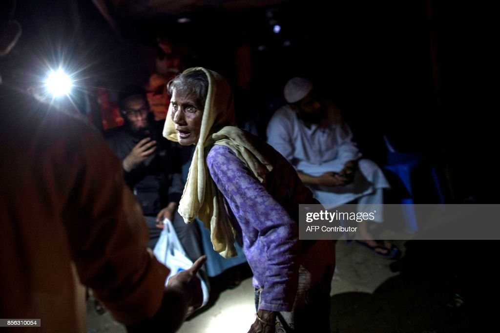 A Rohingya Muslim refugee woman reacts as she arrives at a registration center after they cross the border from Myanmar, in Teknaf on October 1, 2017. Bangladesh is to move to a camp at least 15,000 Rohingya refugees who have settled in a restive hill district near the border with Myanmar, a local official said Sunday. Most of the estimated half a million Rohingya who have arrived in southeastern Bangladesh over the last five weeks after fleeing violence in Myanmar are crammed into the camps that have sprung up on government land. /