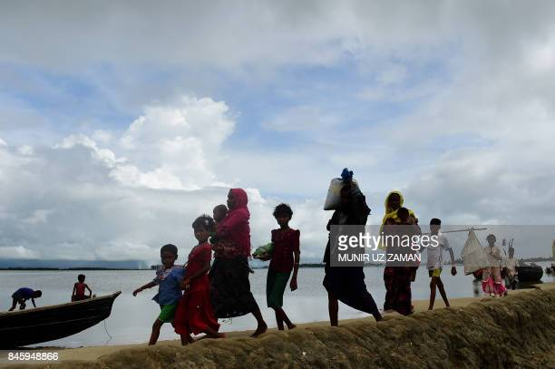 TOPSHOT Rohingya Muslim refugees arrive from Myanmar after crossing the Naf river in the Bangladeshi town of Teknaf on September 12 2017 Some 370000...