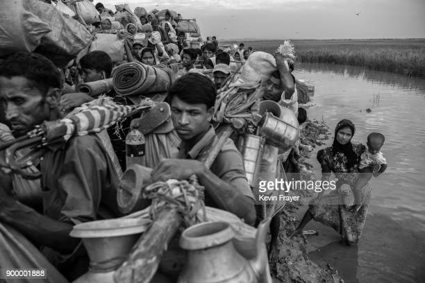 COX'S BAZAR BANGLADESH NOVEMBER 02 Rohingya Muslim refugees crowd as they wait proceed to camps after crossing the border from Myanmar into...