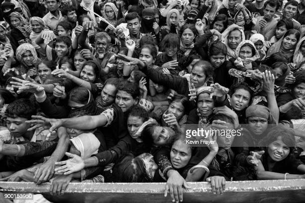 COX'S BAZAR BANGLADESH SEPTEMBER 20 Rohingya Muslim refugees crowd for food aid near Balukhali Refugee Camp on September 20 2017 near Anjuman Para in...