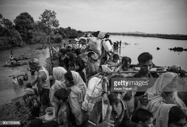 COX'S BAZAR BANGLADESH NOVEMBER 01 Rohingya Muslim refugees crowd on a berm while waiting to be allowed to proceed after fleeing over the border from...