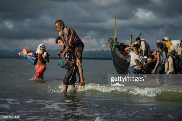 Rohingya Muslim refugees disembark from a boat on the Bangladeshi side of Naf river in Teknaf on September 13 2017 International divisions emerged on...