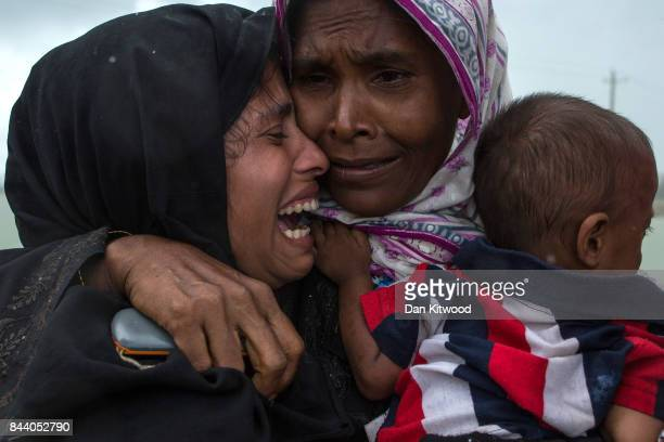 Rohingya Muslim refugees react after being reunited with each other after arriving on a boat from Myanmar on September 08 2017 in Whaikhyang...